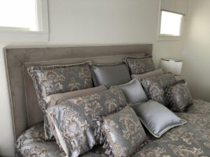 double piped upholstered bedhead